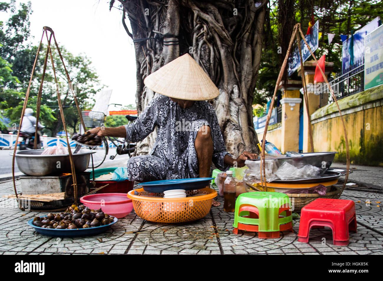 Woman selling shellfish in Hue, Vietnam - Stock Image