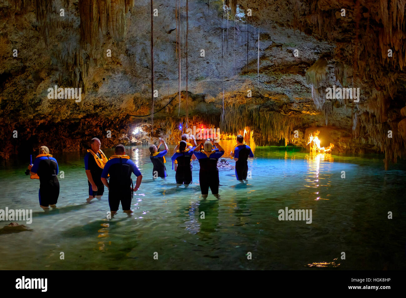 Tourists in the Mexican Cenote or sinkhole at Tak Be Ha, Yucatan Province, Mexico - Stock Image