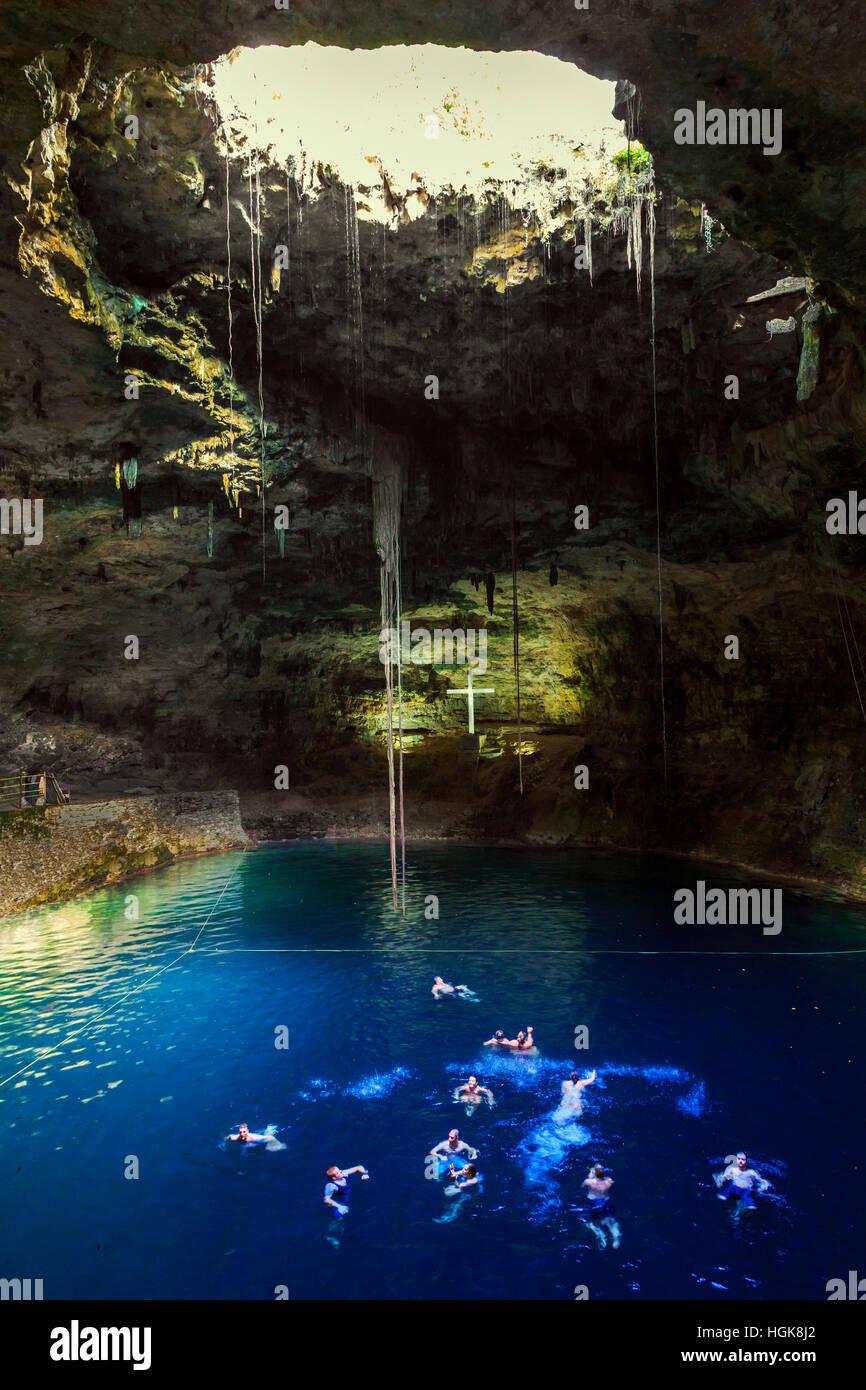 Tourists swimming in the IK KIL cenote sinkhole, Yucatan, Mexico - Stock Image