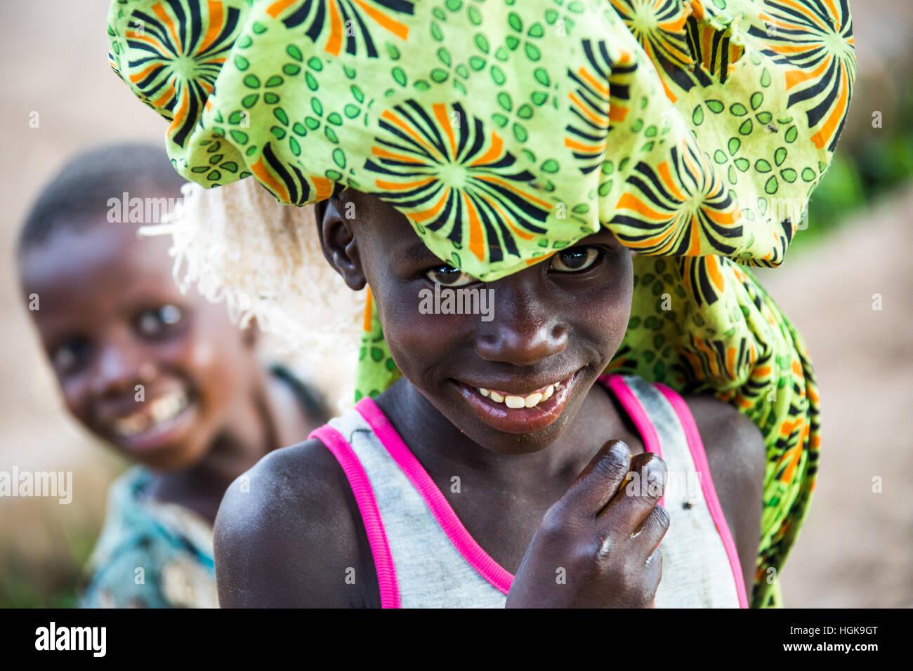 Local child balancing a bundle, Livingstone, Zambia - Stock Image