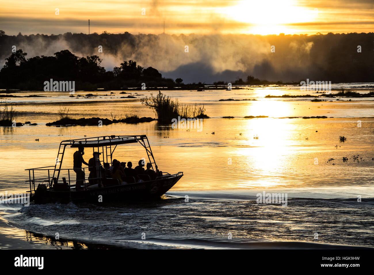 Sunset boat ride above Victoria Falls, Livingstone, Zambia - Stock Image