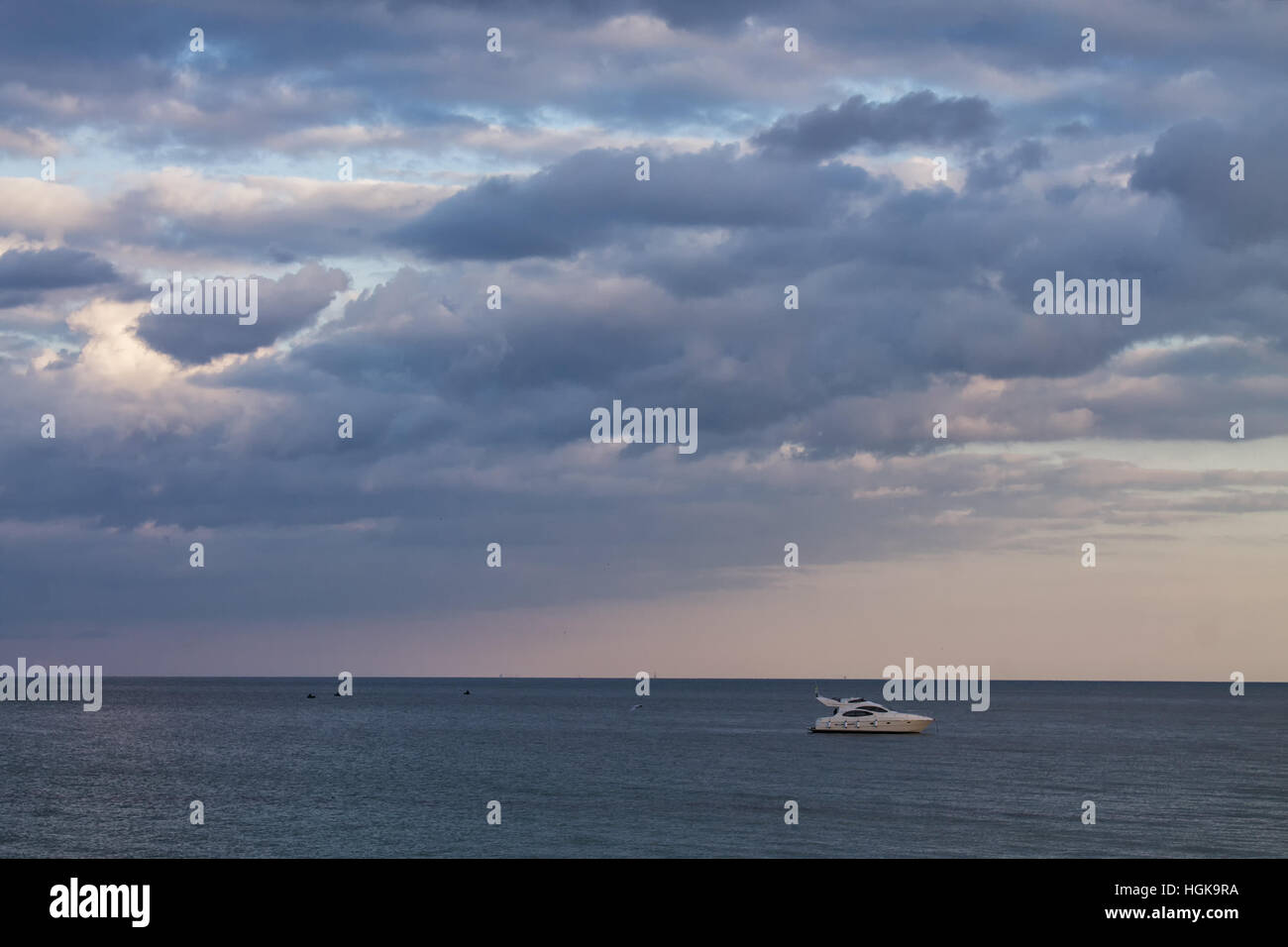 A luxury private yacht under way at sea with amazing cloud sky - Stock Image