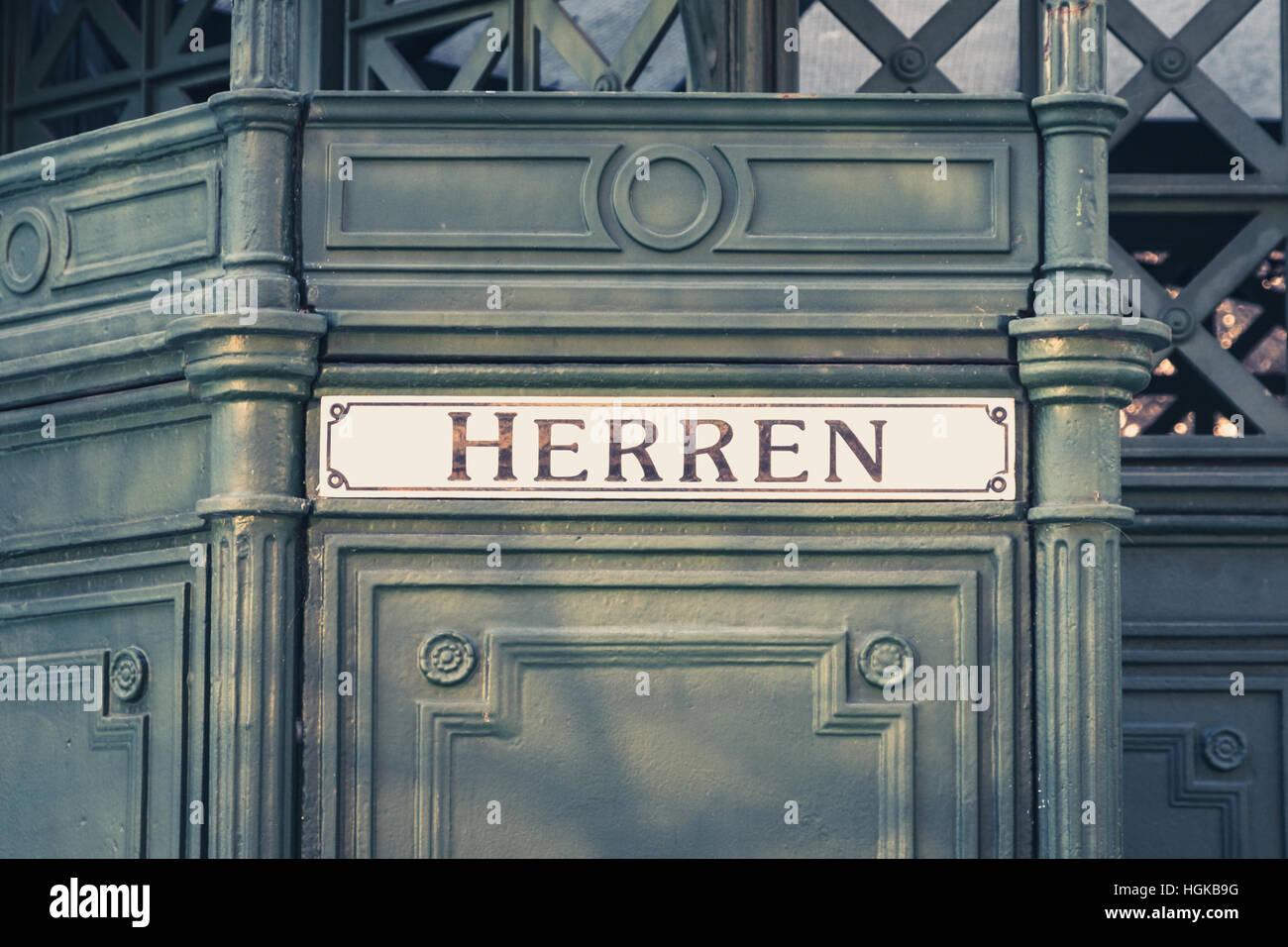 the german word 'Herren' (men) at historic public restroom, - Stock Image