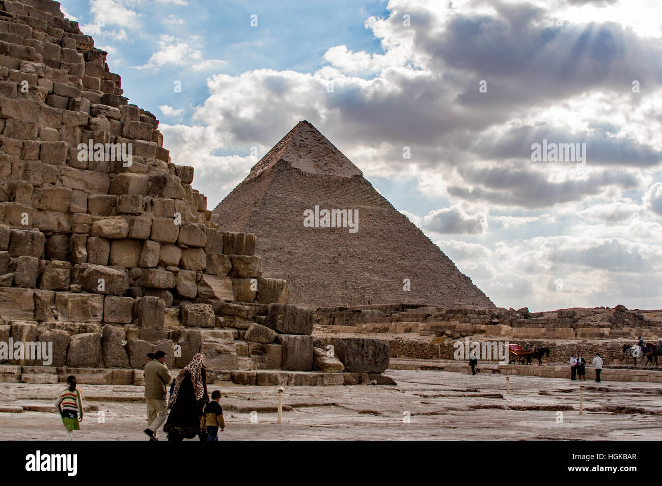 Visiting the great pyramids of Giza in Cairo is popular with locals as well as tourists. Built by 4th dynasty rulers - Stock Image