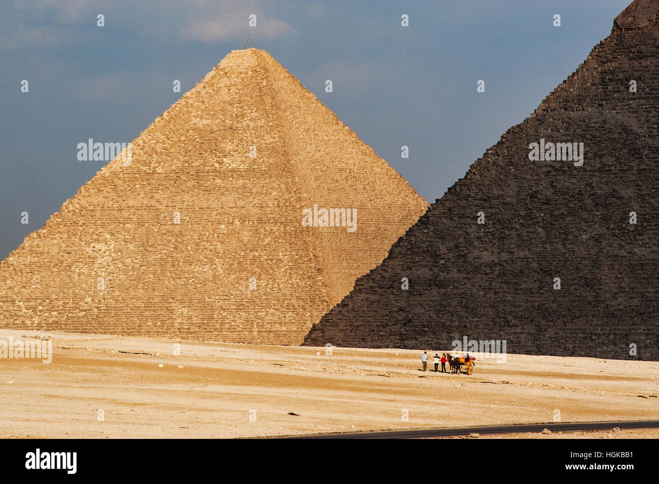 The pyramids of Giza is in southwest part of Cairo is a popular tourist destination. Tours by camel are popular - Stock Image
