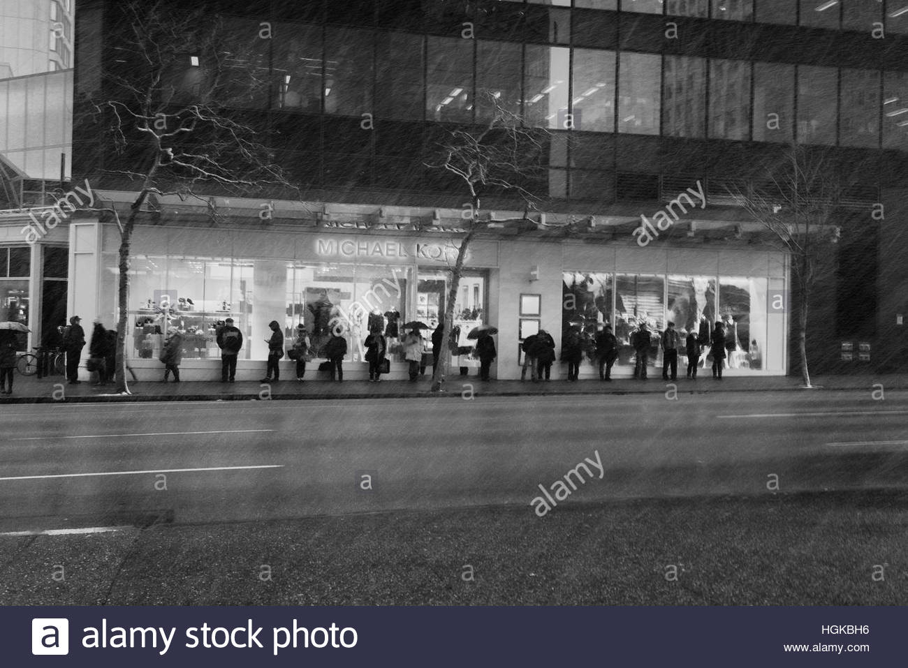 Vancouver, BC, Canada - December 9, 2016 - Transit riders wait along Georgia Street on a snowy morning.  Photo: Stock Photo