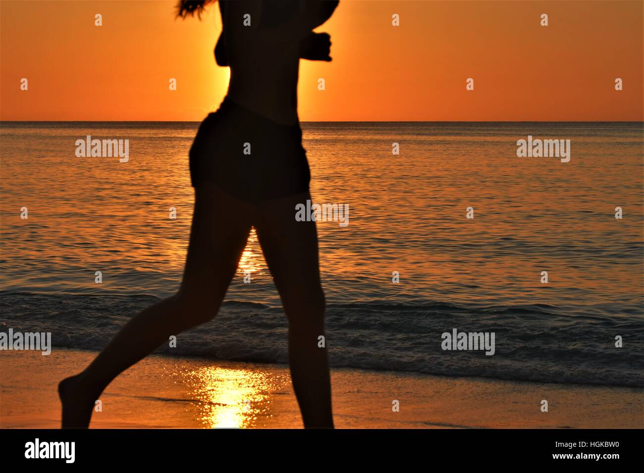 Jogging on the beach - Stock Image