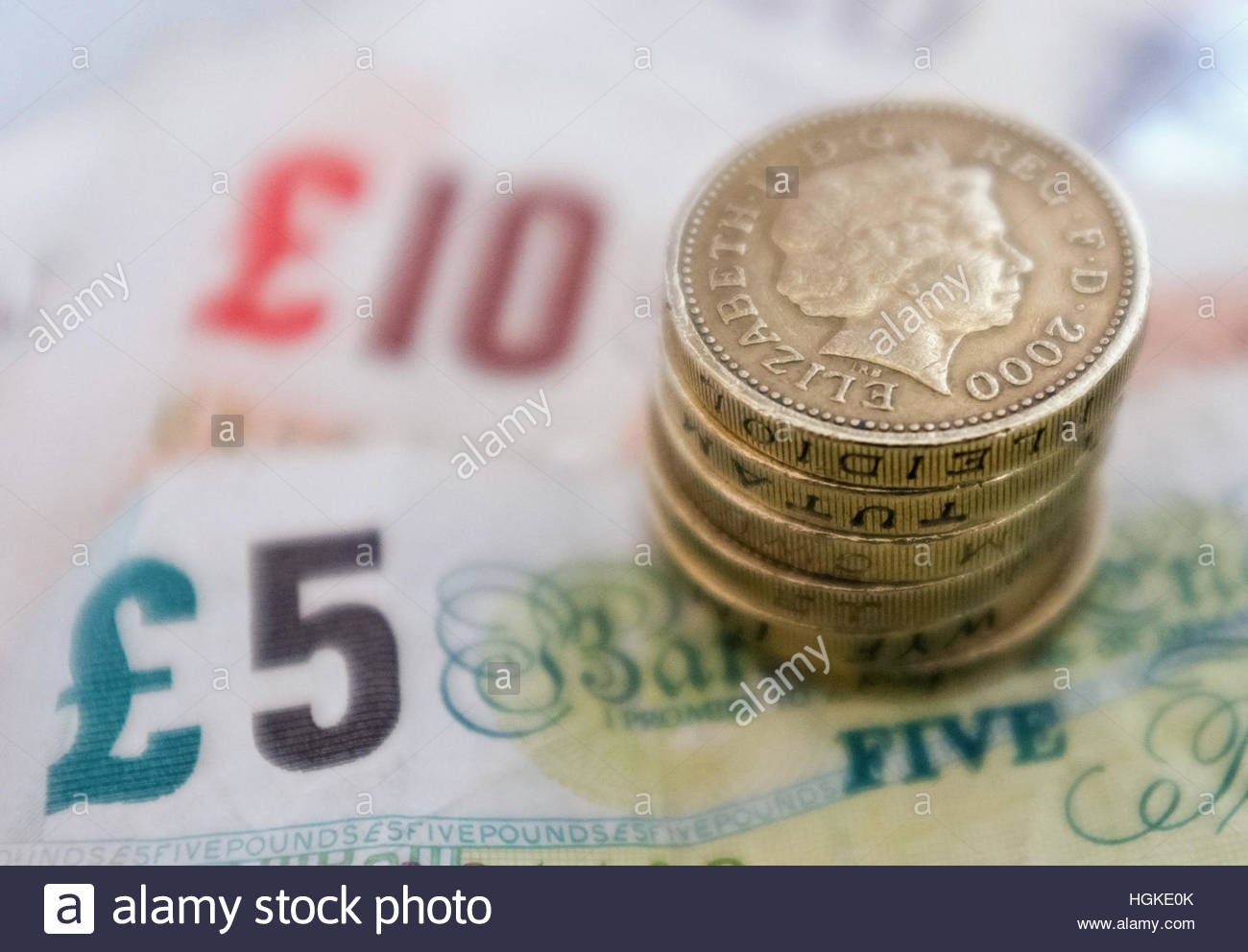 File photo dated 18/09/12 of bank notes and coins, as one in four employees say money worries have affected their - Stock Image