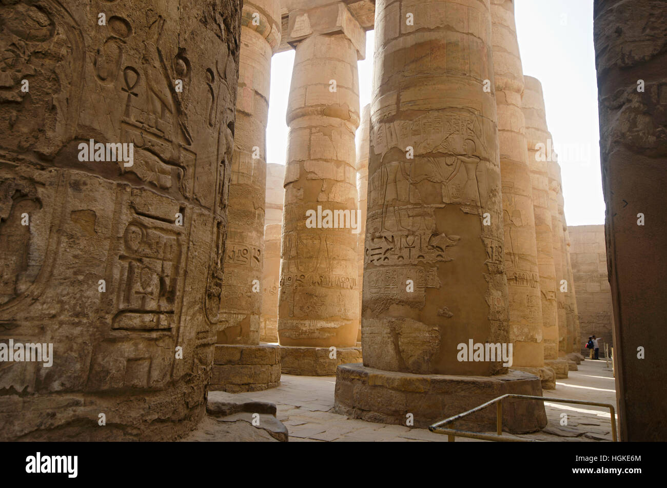 Carved pillars, Built in Yellow Limestone, View of the great hypostyle hall in the Precinct of Amon Re,  Karnak - Stock Image