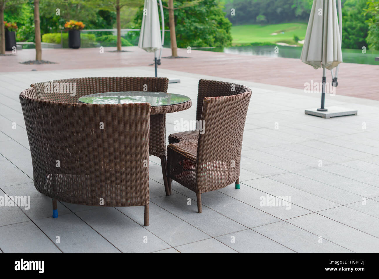 rattan sofa and table set in a garden Stock Photo