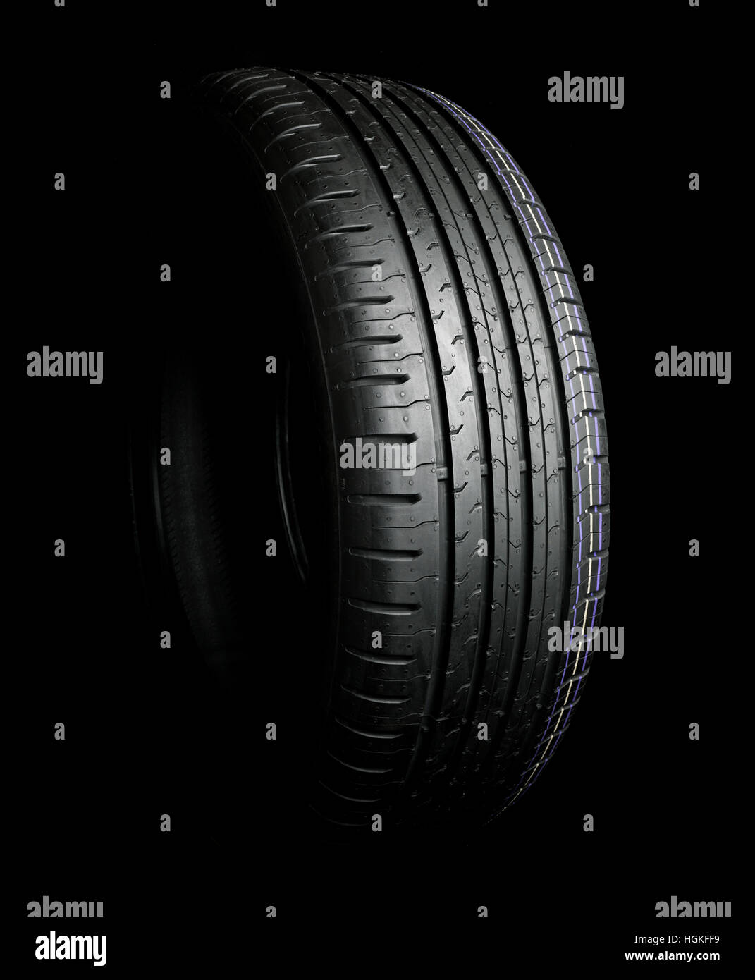 Car Tire isolated on black - Stock Image