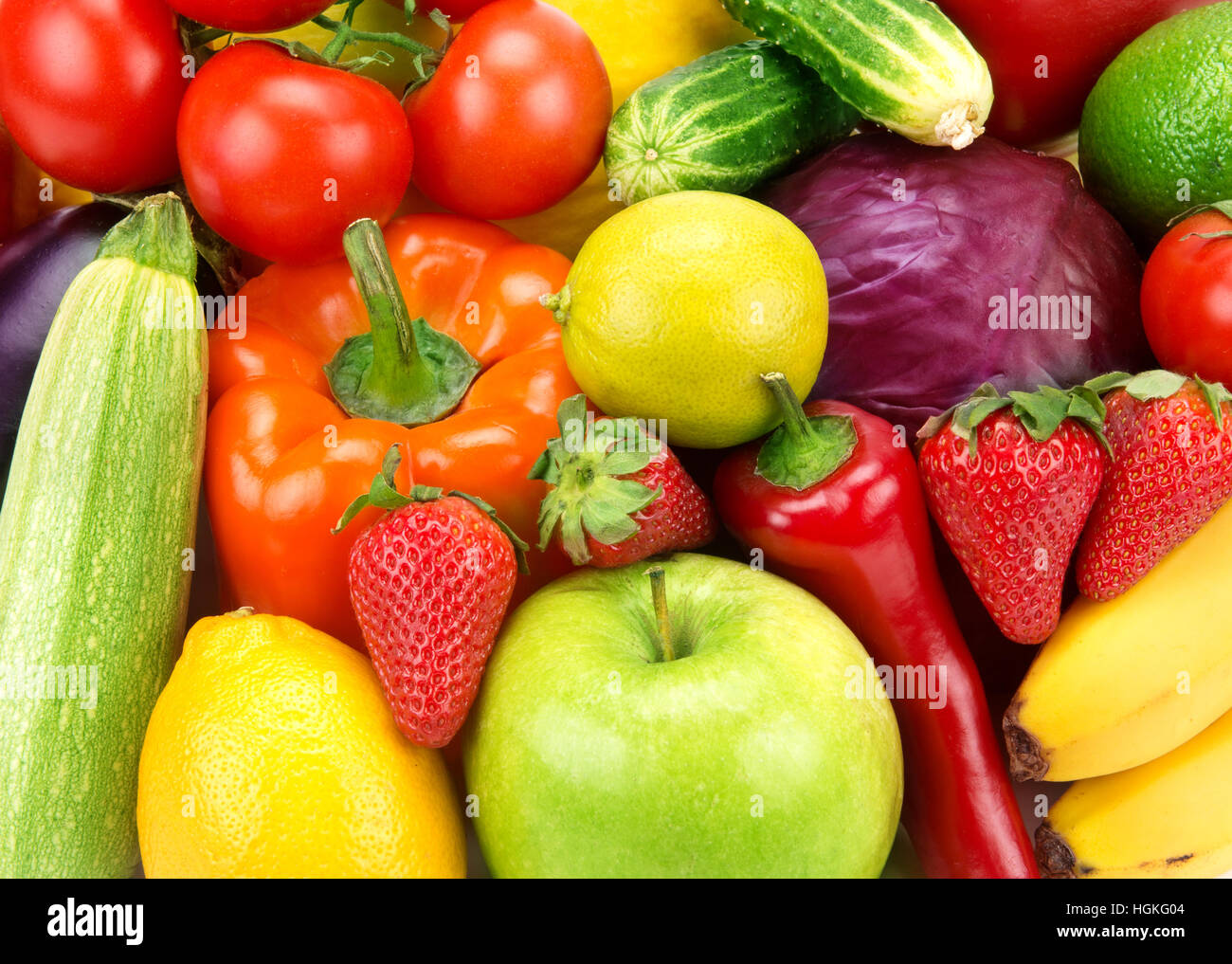 bright background of different fruits and vegetables - Stock Image