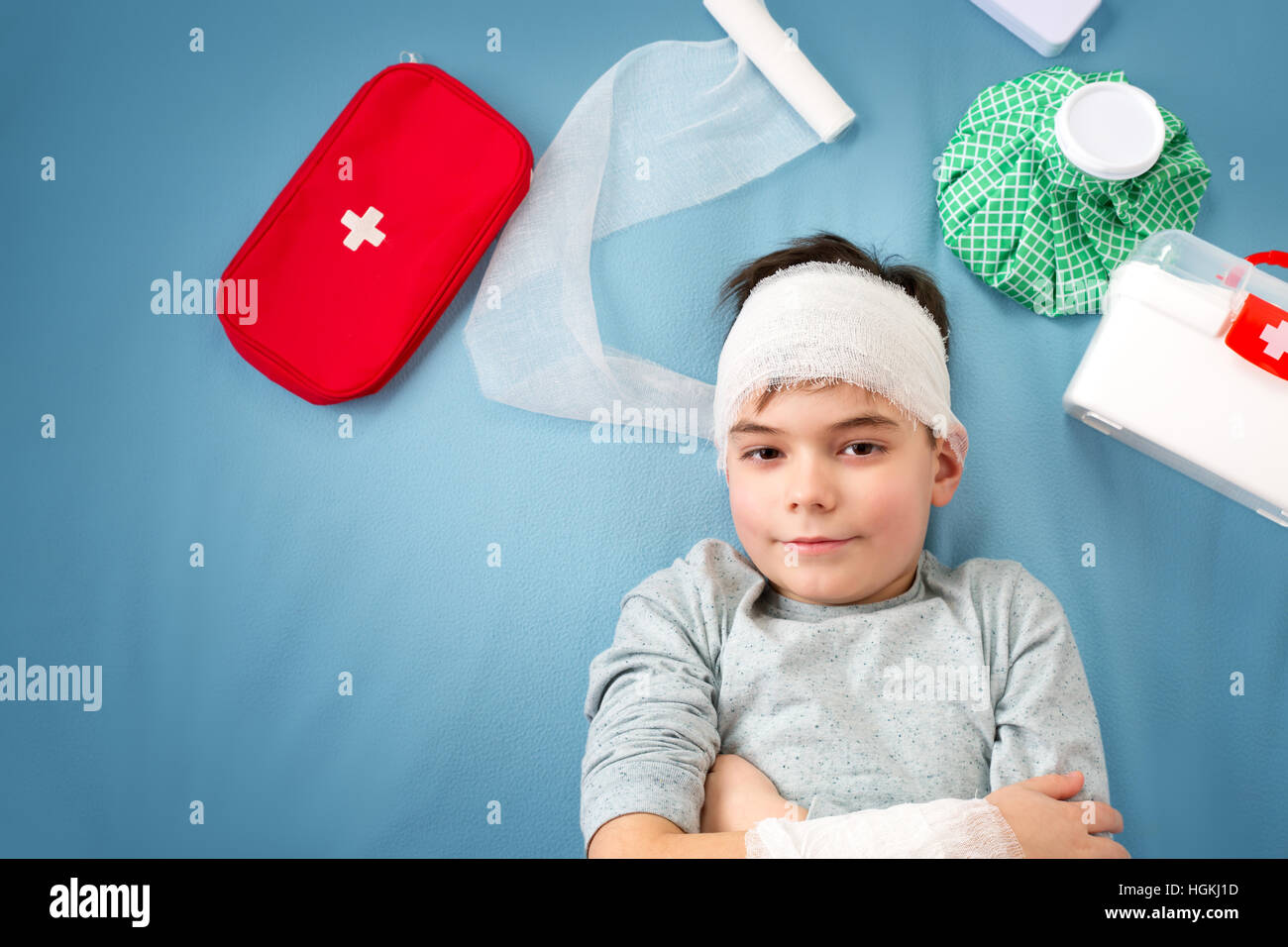 Child with bandages lying in bed - Stock Image