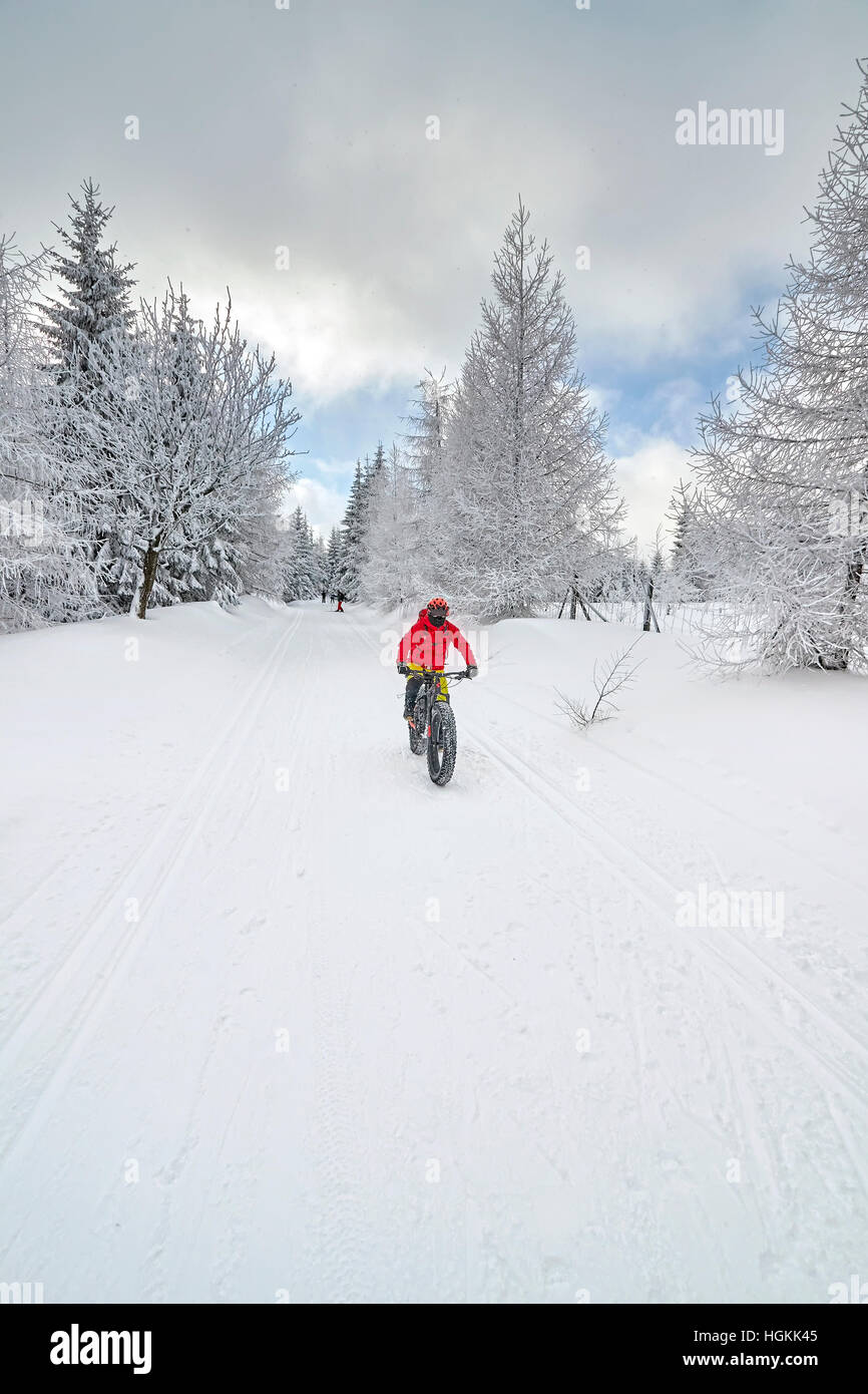 Jakuszyce, Poland - January 06, 2017: Mountain biker riding downhill on snow in winter. - Stock Image