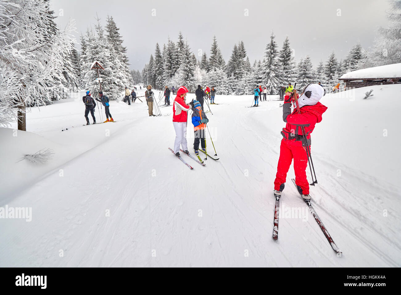 Jakuszyce, Poland - January 06, 2017: Cross-country skiers resting on trails intersection. - Stock Image
