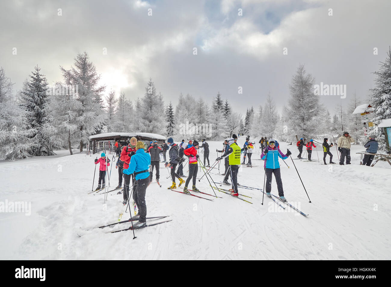 Cross-country skiers resting on trails intersection. - Stock Image