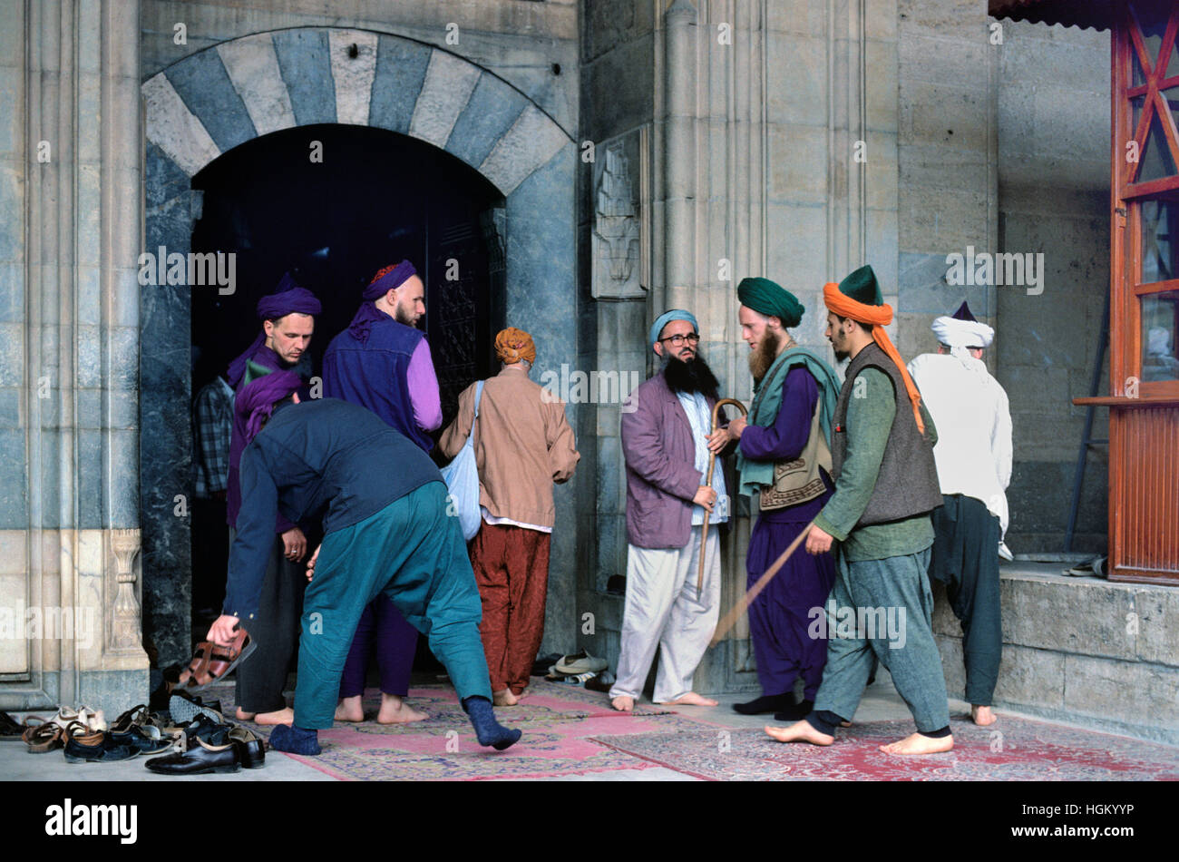 Western Converts to Islam on Pilgrimage Outside the Mevlana Museum or Shrine (1274) Konya Turkey - Stock Image