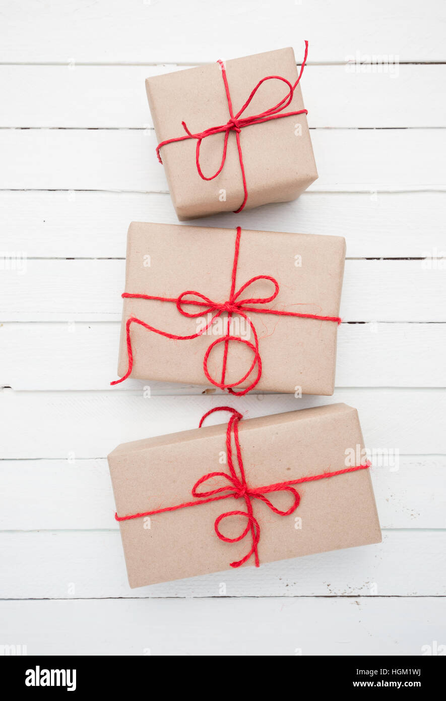 Christmas style rustic brown paper package tied up with strings ...
