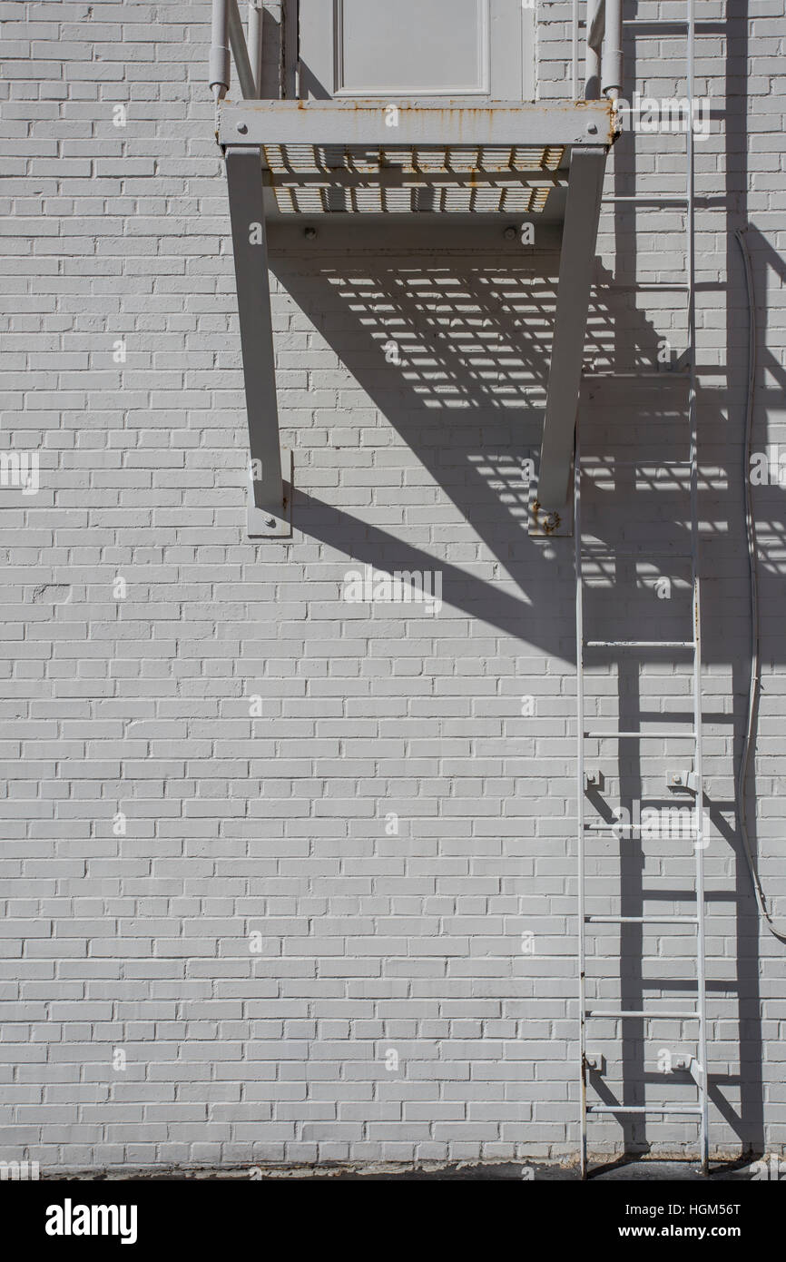 White wall with ladder, Springfield, Illinois, USA - Stock Image