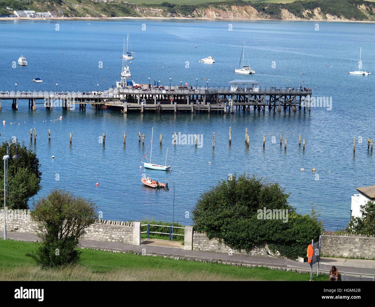 Remains of Old Pier, in front of the new Swanage Pier, Dorset, England - Stock Image