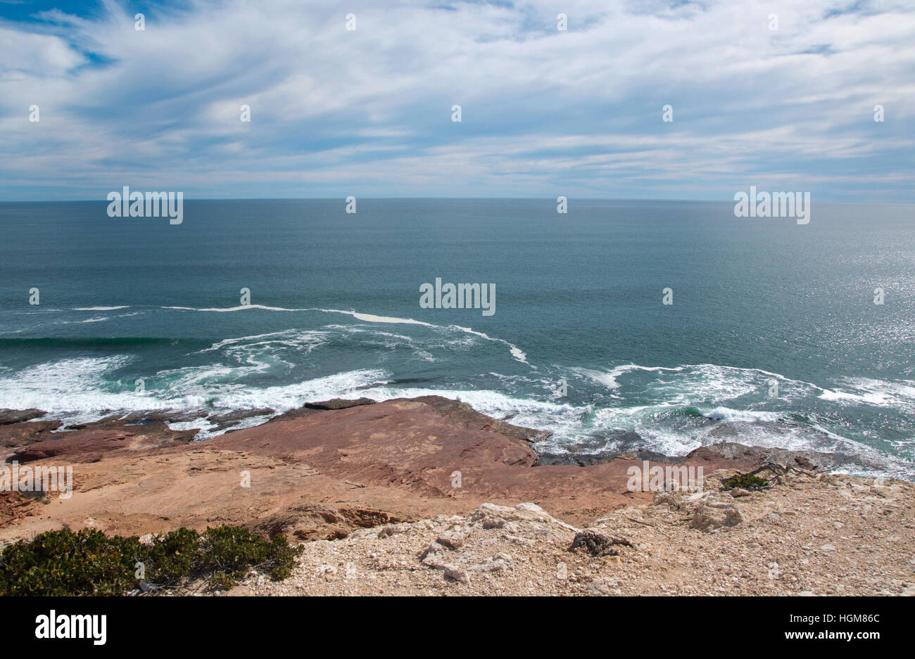 Cloudy skies over the turquoise Indian Ocean seascape and sandstone coast at Red Bluff in Kalbarri, Western Australia. - Stock Image
