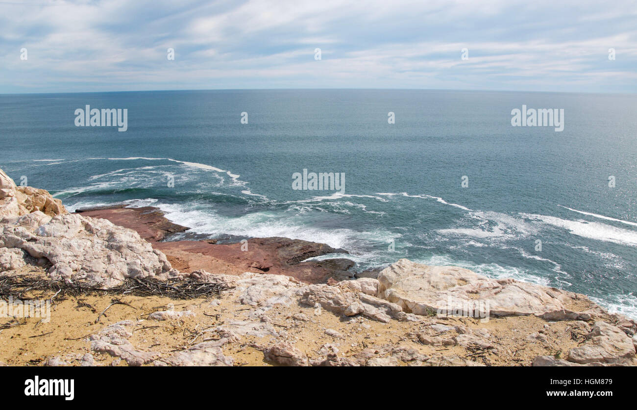 Scenic view at Red Bluff with rugged sandstone cliffs and the Indian Ocean seascape in Kalbarri, Western Australia - Stock Image