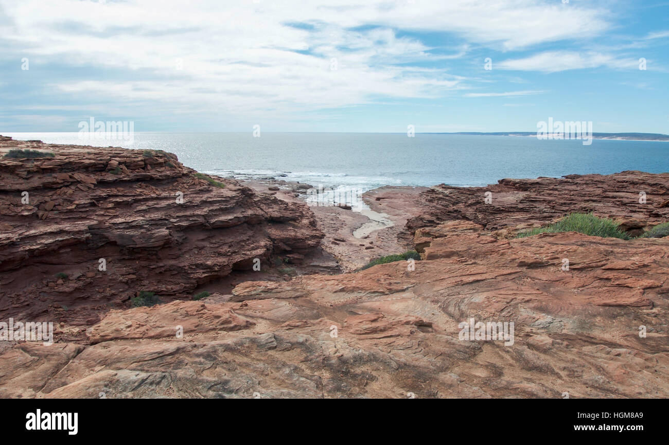 Scenic Indian Ocean seascape at Red Bluff with rugged coastal sandstone and small inlet in Kalbarri, Western Australia. - Stock Image