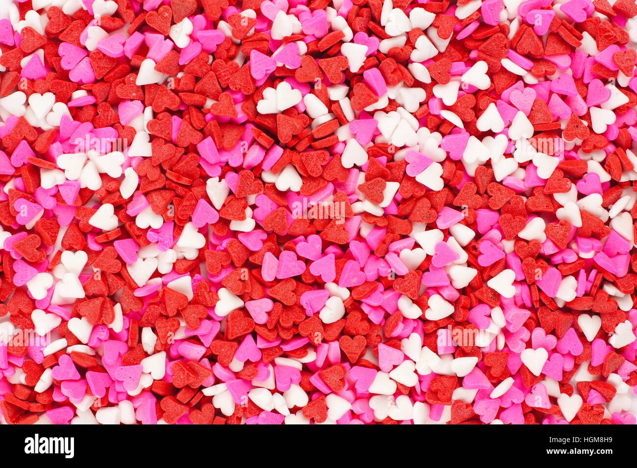 Valentines Day candy heart sprinkles background - Stock Image