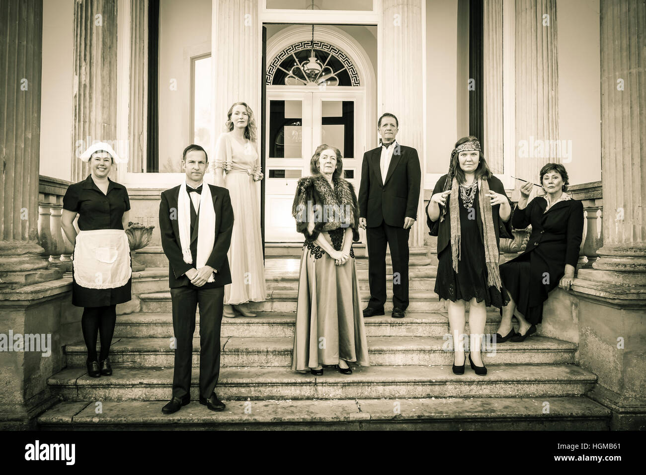English aristocratic family and servant on steps of stately home - Stock Image