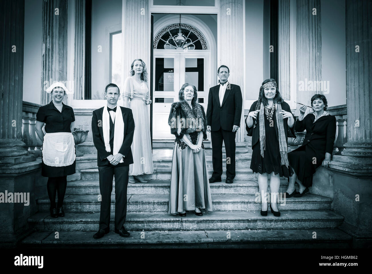 posh english family and servant on steps of stately home - Stock Image