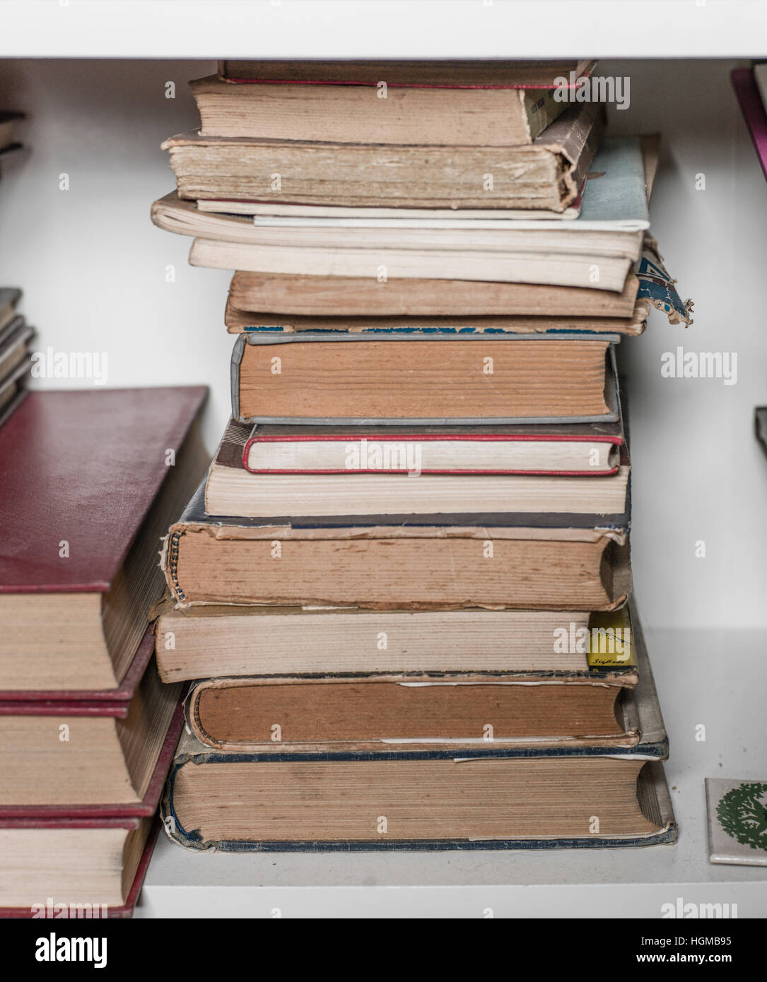 Old books in a library - Stock Image