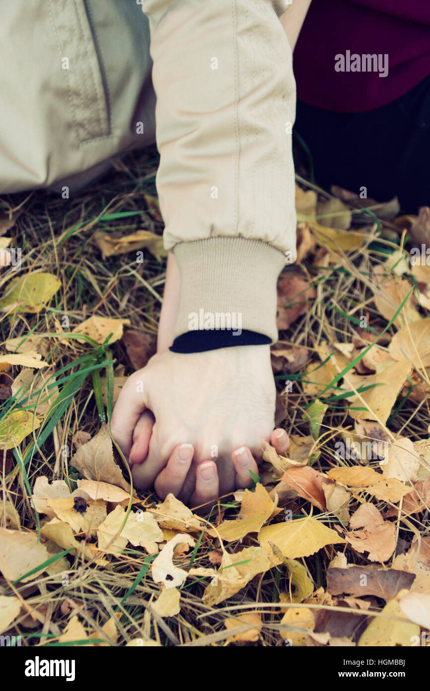 Young couple holding hands Stock Photo