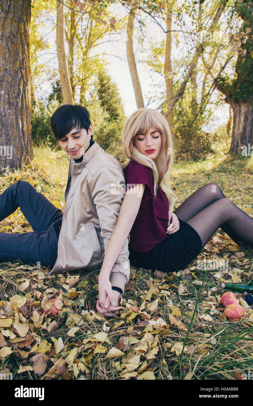 Young couple in a date at a beautiful natural place in autumn - Stock Image