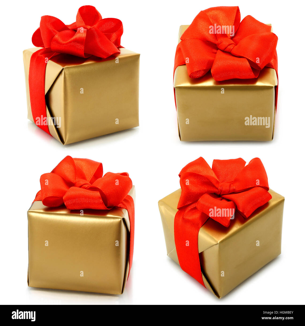 Set of golden gifts with red bow on white background Stock Photo