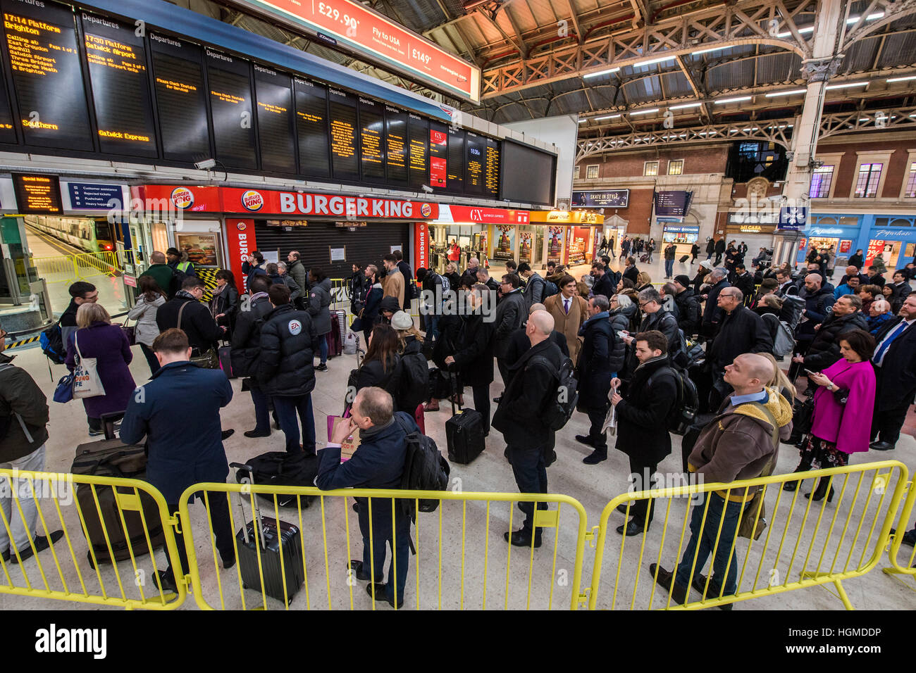 London, UK. 10th January, 2016. Queueing for the Gatwick Express which was running a half hourly service - Evening - Stock Image