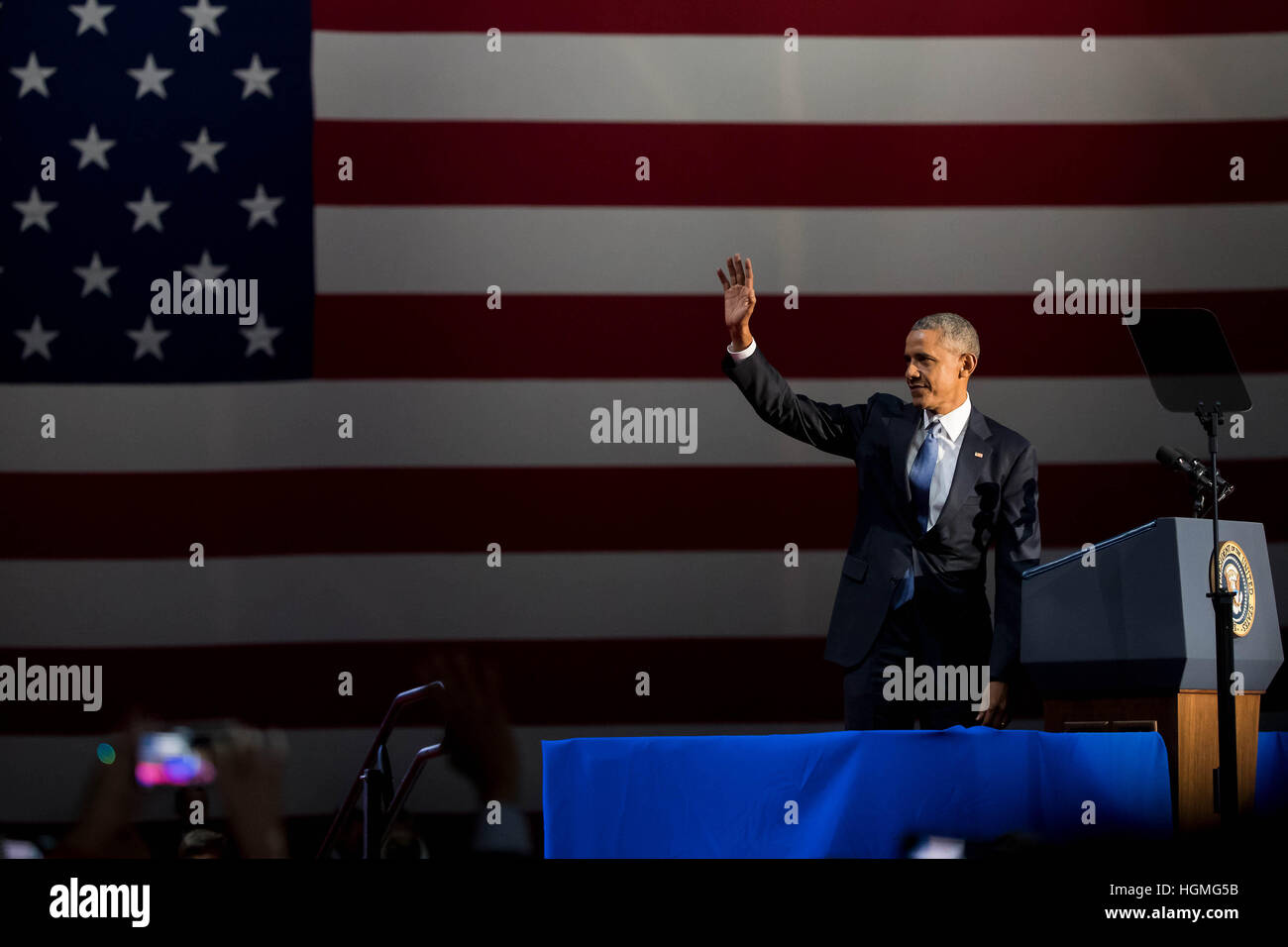 Chicago, USA. 10th Jan, 2017. U.S. President Barack Obama waves to the audience before delivering his farewell address - Stock Image