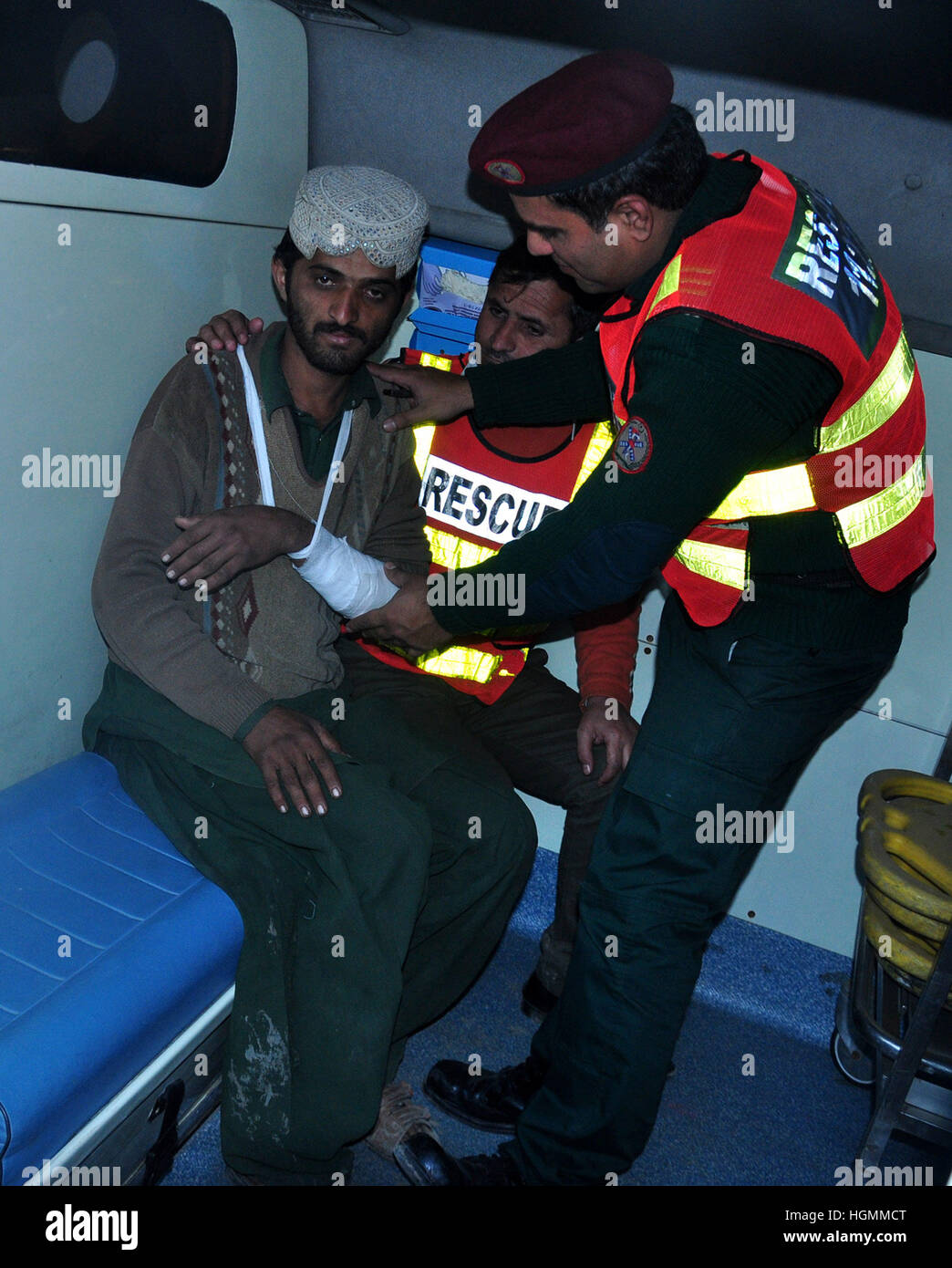 Lahore. 11th Jan, 2017. Rescuers help an injured man after a fire in eastern Pakistan's Lahore on Jan. 11, 2017. - Stock Image