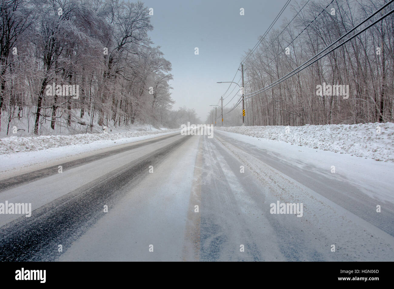 Winter icy cold road conditions 1. - Stock Image