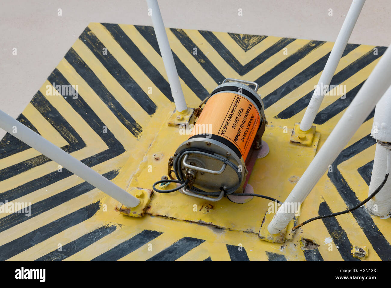 Maritime Black Box voice and data recorder mounted on ship foredeck. - Stock Image