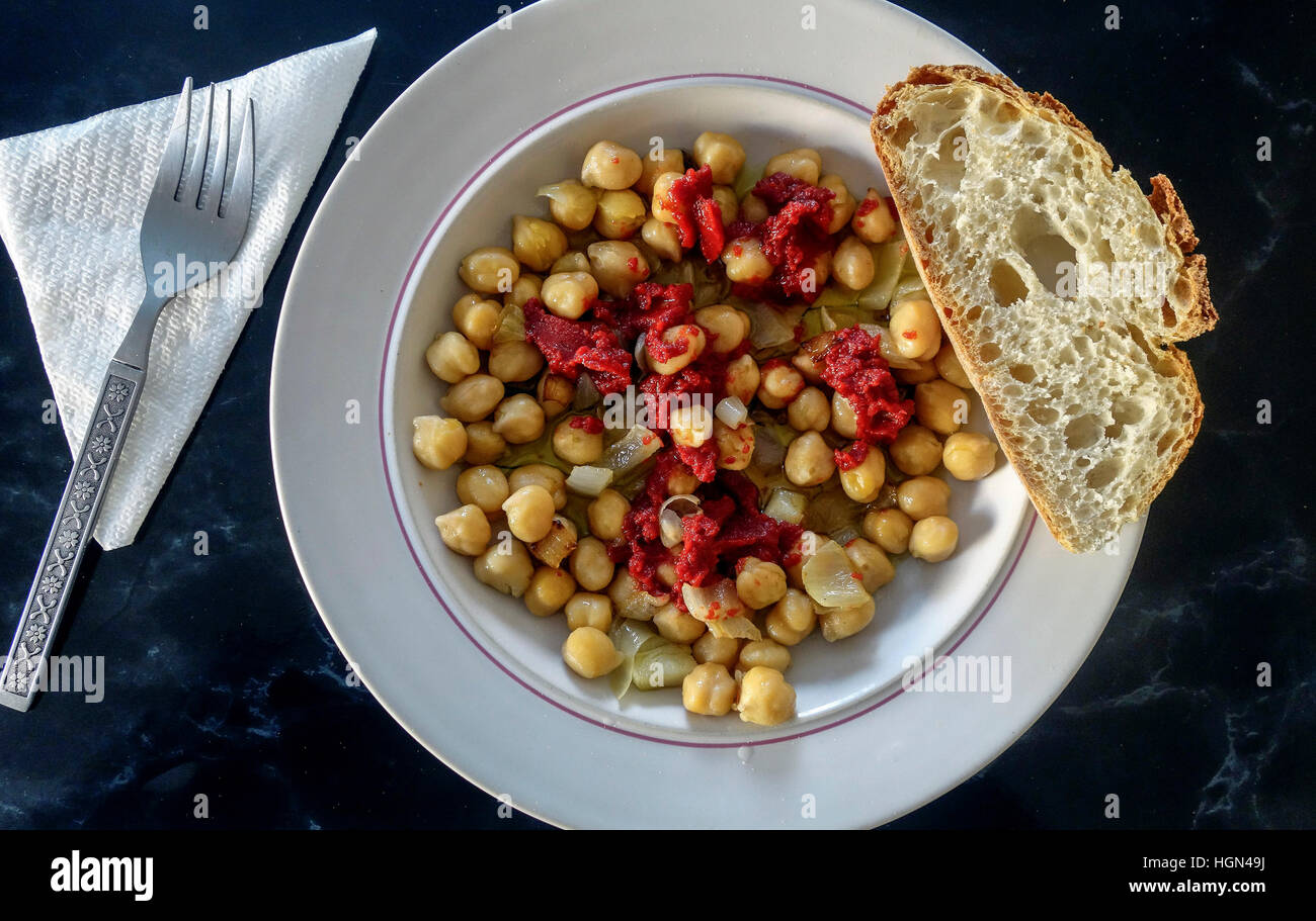 Tasty Chickpeas with Onions and Tomato Sauce - Stock Image