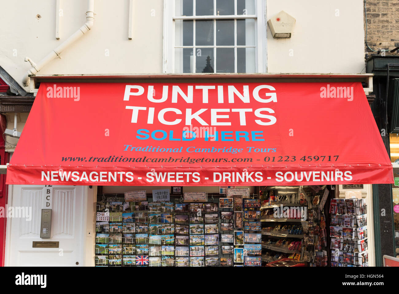 An advert for punting tickets on an awning over a shop in King's Parade Cambridge UK - Stock Image