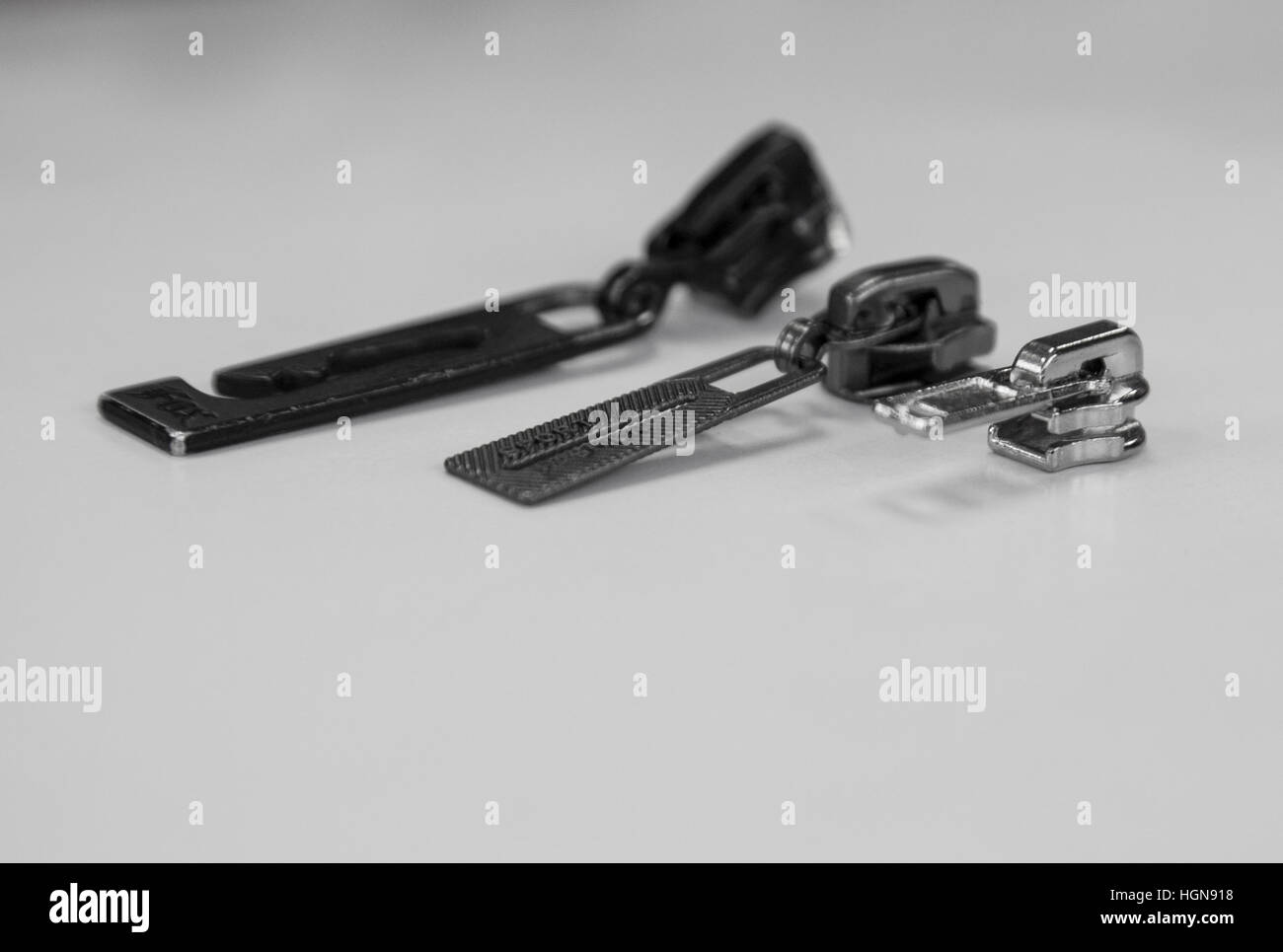 three zippers all different sizes - Stock Image