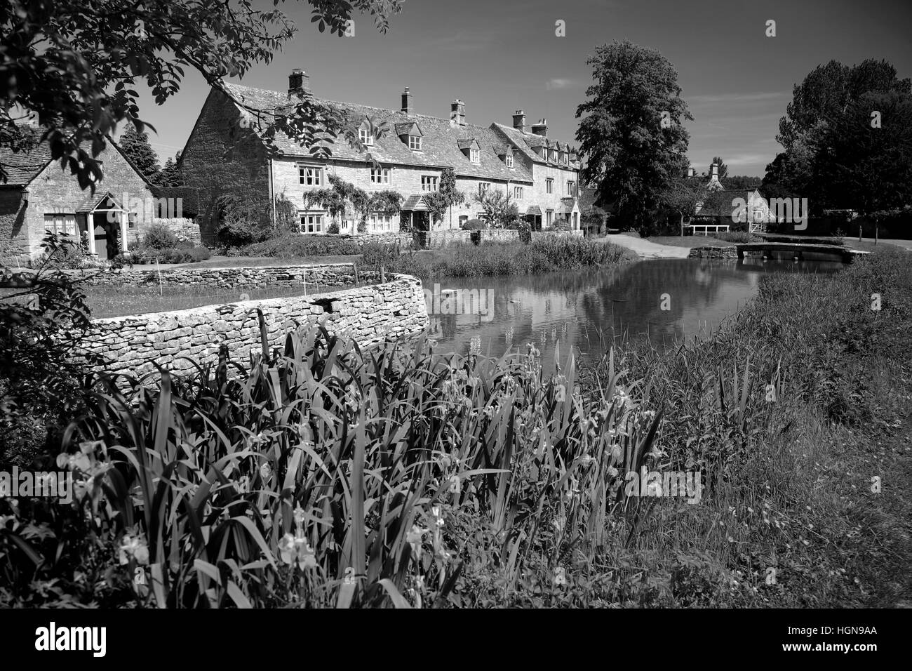 Summer, The Old Watermill and Cottages, river Windrush, Lower Slaughter village,  Gloucestershire Cotswolds, England, - Stock Image