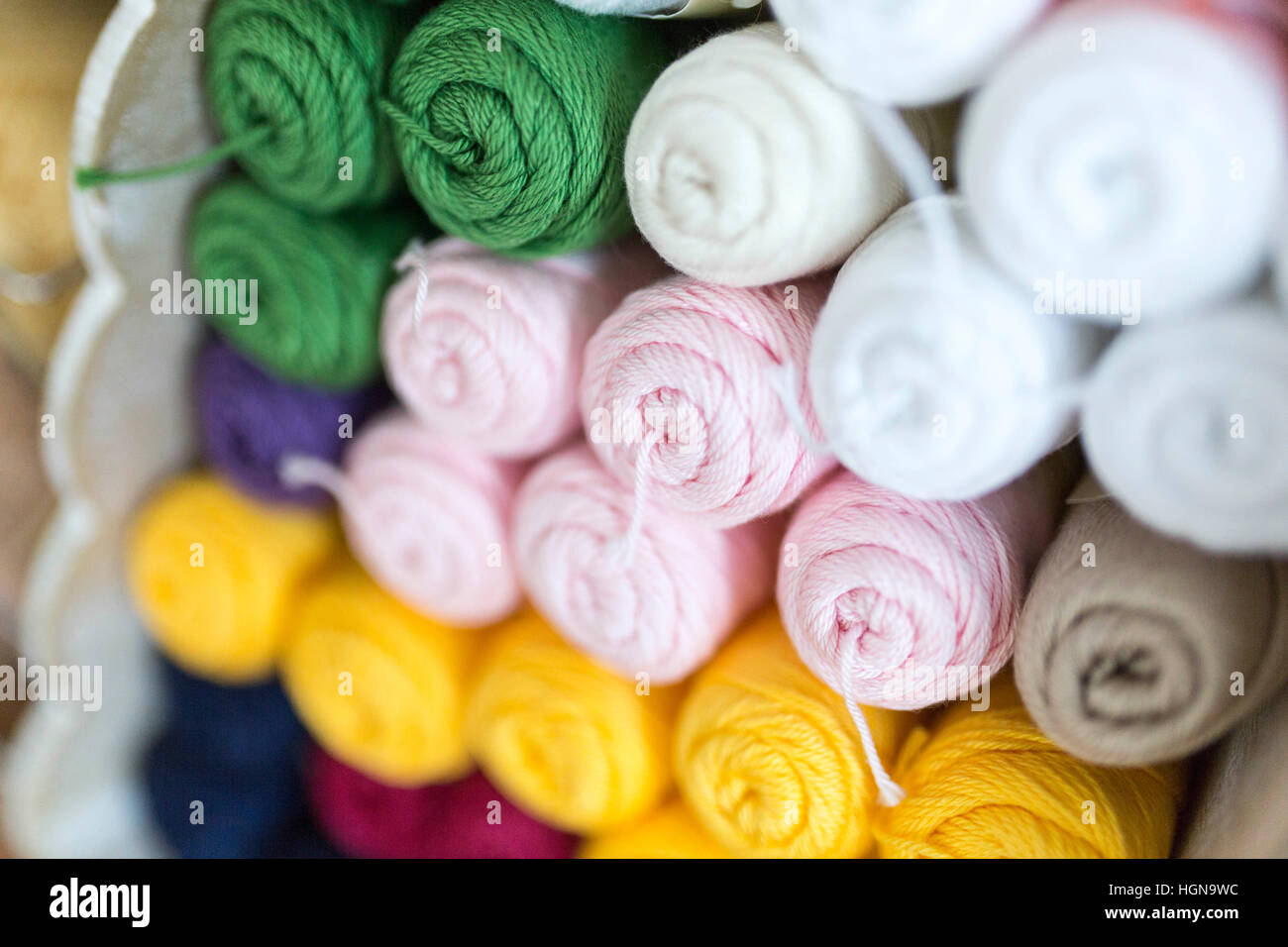 Knitting - rolls of soft wool - Stock Image