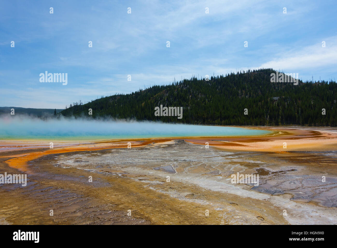 Famous trail of Grand Prismatic Springs in Yellowstone National Park. Beautiful  hot springs with vivid color in - Stock Image