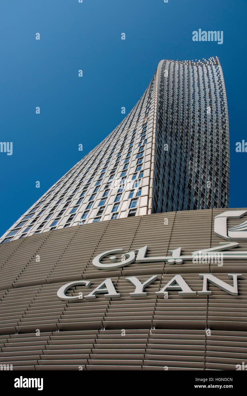 Low angle view of Cayan Tower, Dubai Marina residential district, Dubai, United Arab Emirates - Stock Image
