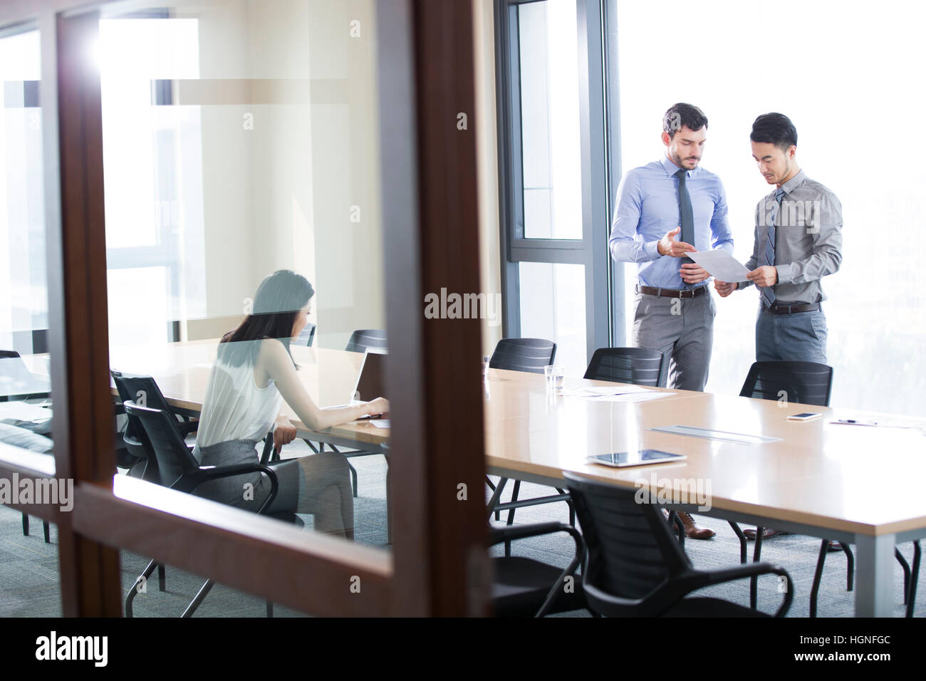 Business people talking in meeting room - Stock Image