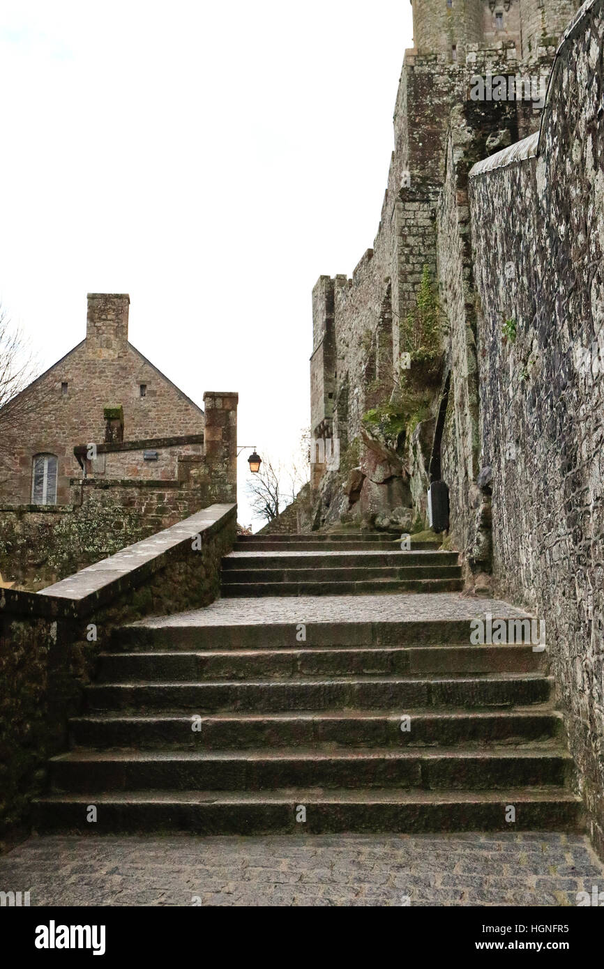 The Island of Mont St Michel on a cloudy & wet day in Normandy, France (St. michaels mount) Stock Photo