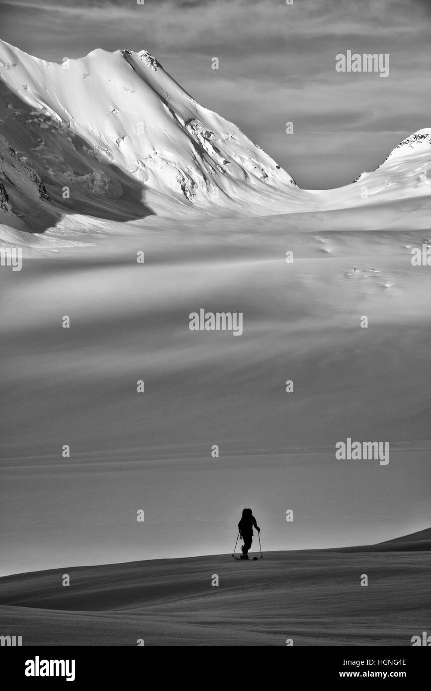 A single ski tourer in the Bernese Oberland, Switzerland - Stock Image