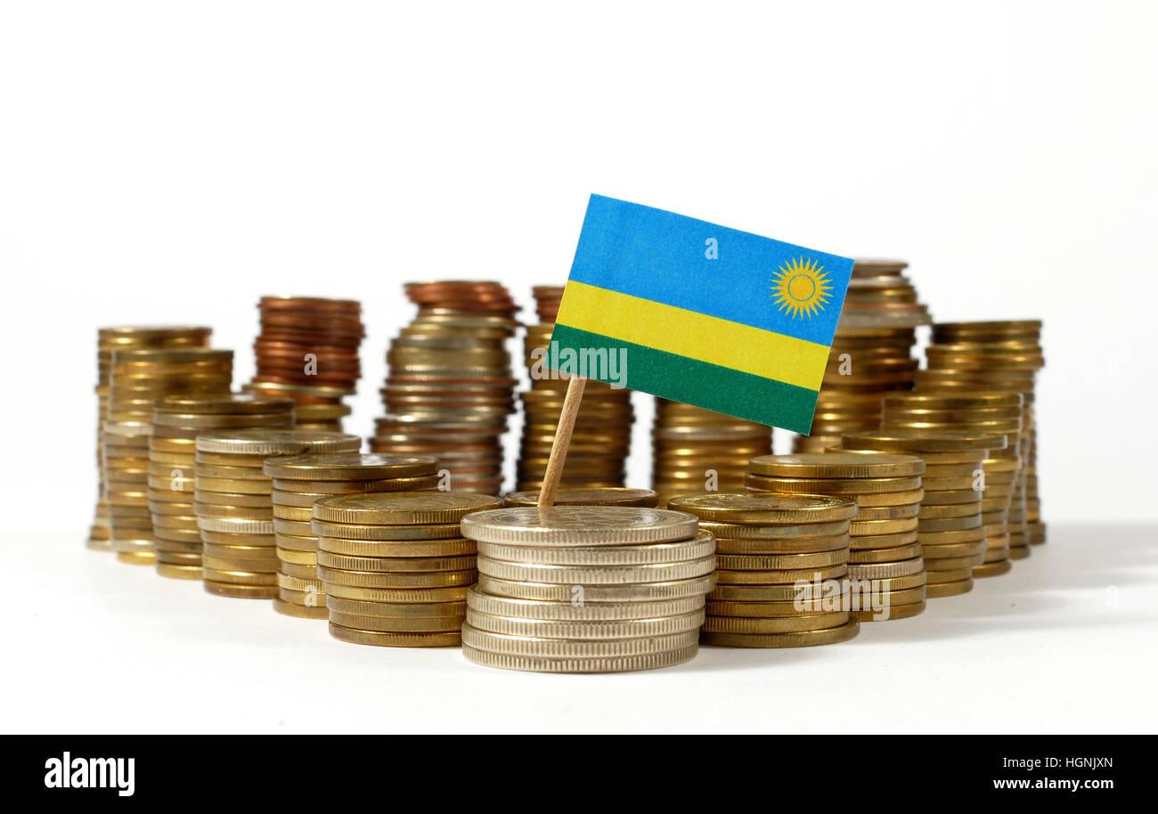 Rwanda flag waving with stack of money coins - Stock Image